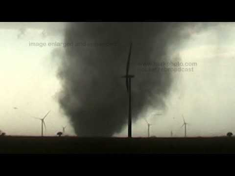 An EF-3 tornado destroys a wind turbine south of Spivey and west of Duquoin in Harper County, Kansas. The HD video is shown at normal size, then it repeats with the video enlarged and enhanced to show the blades ripped off the wind turbine and flying through the air.