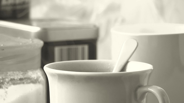 Pouring water on the tea leaves. Steaming black english tea. Slow motion, black and white