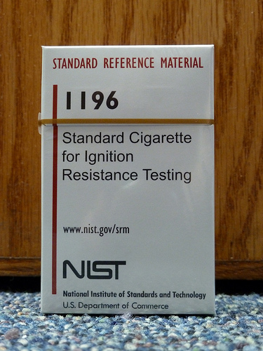 """> Cigarettes are the most frequent cause of fatalities from residential fires in the United States. So, it might seem surprising to learn that a cigarette that burns stronger than others has been used for decades by manufacturers of home furnishings to test the fire resistance of their products. Making certain that they can continue this life- and property-saving effort is the job of a new standard reference material (SRM) from the National Institute of Standards and Technology (NIST). > > NIST SRM 1196, """"Standard Cigarette for Ignition Resistance Testing,"""" consists of 10 packs of uniform cigarettes designed to replicate the ignition performance of the """"hottest burning"""" brand produced in the 1970s when NIST studied the fire-starting propensity of commercially sold tobacco products. The standard cigarettes are designed to be placed on a mattress, a piece of upholstered furniture or furniture components to verify if these items have been manufactured to meet mandatory and voluntary federal, state and/or industry guidelines for resistance to ignition by burning cigarettes. The cigarettes were developed by NIST in conjunction with the U.S. Consumer Product Safety Commission (CPSC) to replace the commercial cigarettes that had been used for 30 years of home furnishings testing but are no longer in production.  [http://www.nist.gov/el/fire\_research/cigarette\_092810.cfm](http://www.nist.gov/el/fire_research/cigarette_092810.cfm)"""