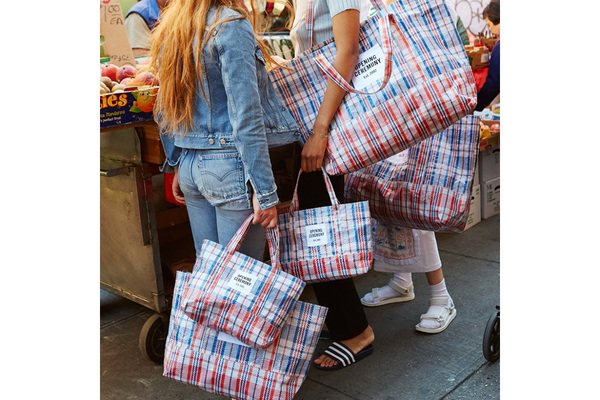 opening-ceremony-is-selling-totes-inspired-by-hong-kongs-notorious-plaid-bags-1170x780.jpg