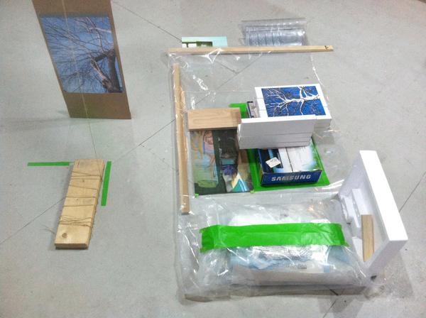 2014 Digital prints, cardboard, vinyl, found packaging, wood, debris.