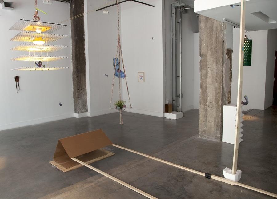 Wood, styrofoam, grass rope, nautical cleats, found packaging and ephemera.