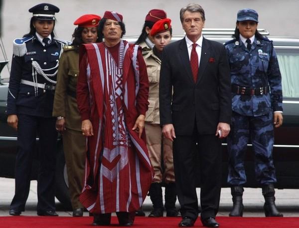 Libyan-leader-Muammar-Gaddafi-L-and-Ukraine-s-President-Viktor-Yushchenko-take-part-in-an-official-welcoming-ceremony-as-Libyan-bodyguards-look-on-in-Kiev-November.jpg