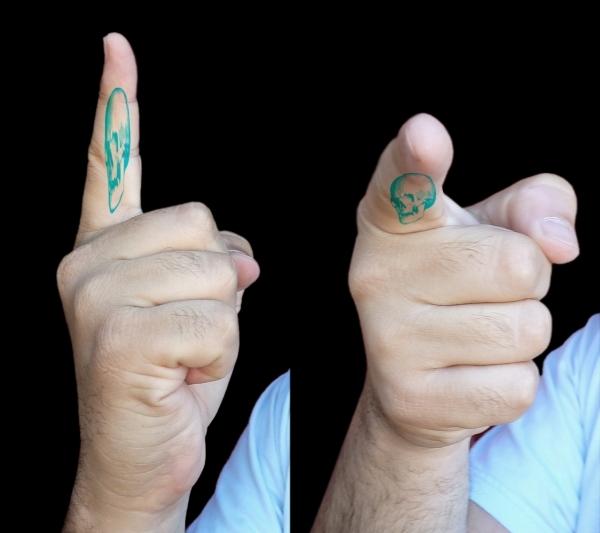 67_memento-mori-tattoo-finger.jpg