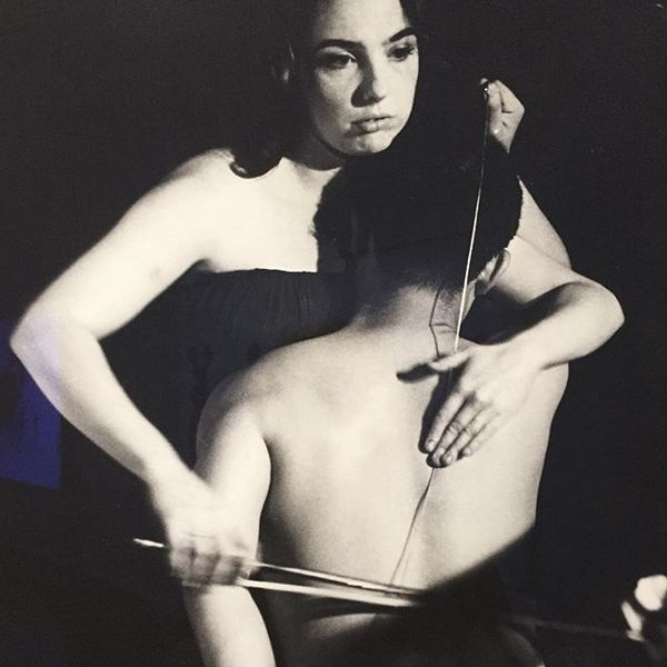1965, Charlotte Moorman playing human cello (w/ Nam June Paik) photo by Peter Moore