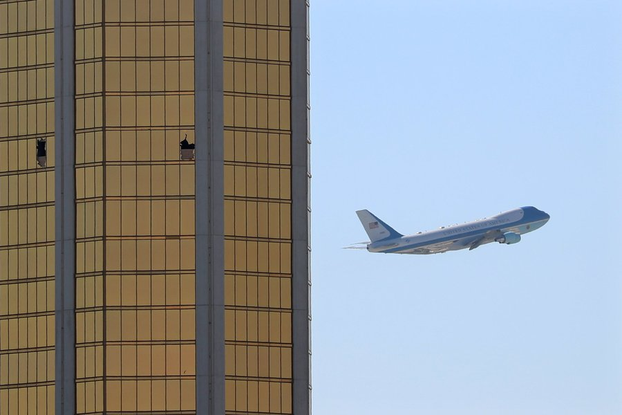 Air Force One departs Las Vegas past the broken windows on the Mandalay Bay hotel. (Photo: Mike Blake/Reuters)
