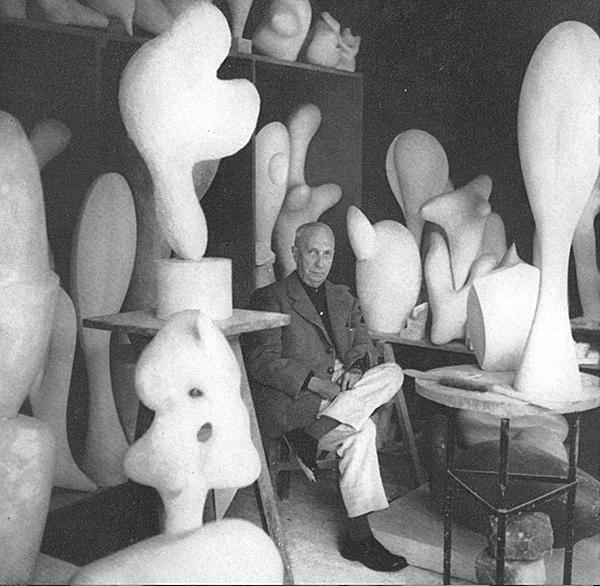 jean-arp-in-his-studio-with-sculpture.jpg