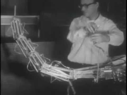 This film from 1968 shows Marvin Minsky's tentacle arm, developed at the MIT AI Lab (one of CSAIL's forerunner labs). The arm had twelve joints and could be controlled by a PDP-6 computer or via a joystick. This video demonstrates that the arm was strong enough to lift a person, yet gentle enough to embrace a child.