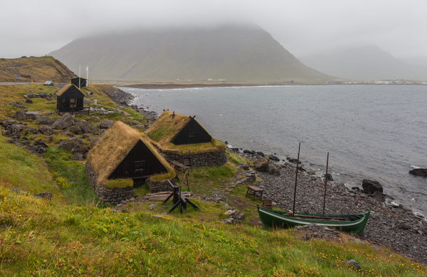 An example of a very small museum: A maritime museum located in the village of Bolungarvík, Vestfirðir, Iceland showing a 19th-century fishing base: typical boat of the period and associated industrial buildings.
