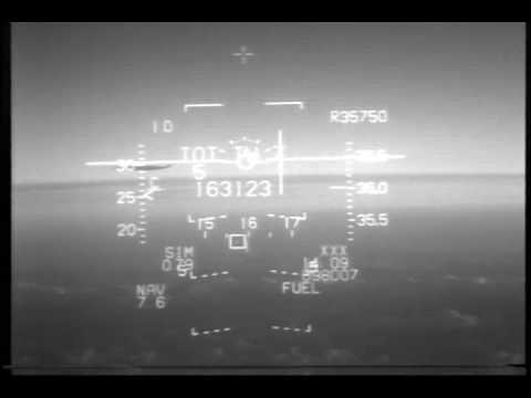 Filmed from the fighter's cockpit. At time 03:30 you see the contrails of the commercial jet appearing at the horizon on the left side. In the end you can clearly see the jet.