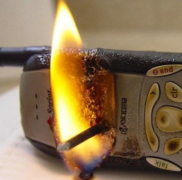 burning-phone-on-fire-e1338592881679.jpg