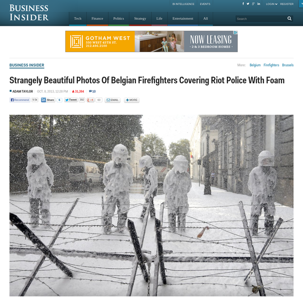 Strangely Beautiful Photos Of Belgian Firefighters Covering Riot Police With Foam