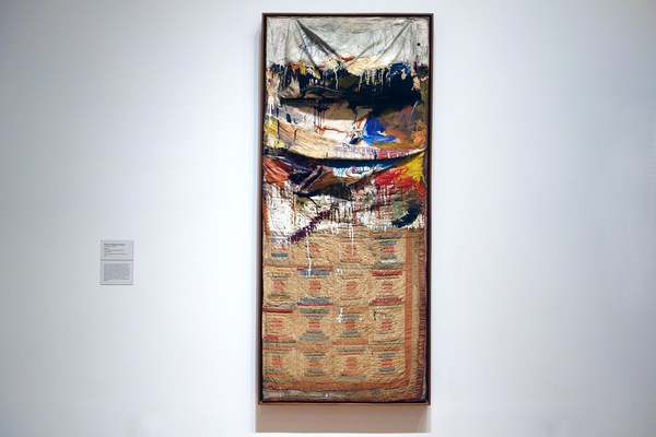 "1955. Oil and pencil on pillow, quilt, and sheet on wood supports, 75 1/4 x 31 1/2 x 8"" (191.1 x 80 x 20.3 cm)"