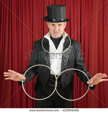 stock-photo-magician-with-classic-metal-ring-props-posing-on-stage-422948488.jpg
