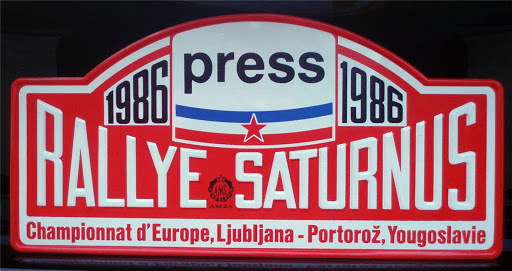 Rally Saturnus is a car racing championship that took place yearly in May in Slovenia, Yugoslavia since 1978.  Here is a picture of a journalist car plate for 1986 rally.