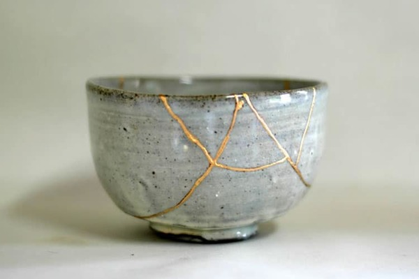"""Kintsugi means """"golden repair"""" in Japanese. It is the old Japanese art of fixing broken pottery with a special lacquer dusted with powdered gold, silver, or platinum. Beautiful seams of gold glint in the cracks of ceramic ware, giving a unique appearance to the piece.  The method of fixing broken object, Kintsugi, also reflects back to the Imperfectness in Japanese art, known as wabi-sabi."""