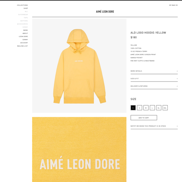 YELLOW 100% COTTON 10 OZ FRENCH TERRY AIMÉ LEON DORE SCREEN PRINT KANGA POCKET RIB KNIT CUFFS & WAISTBAND ALD LOGO HOODIE IN DARK YELLOW. MADE IN CANADA. FEATURES 100% COTTON 10 OZ FRENCH TERR