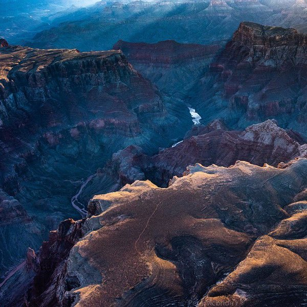 """Photo by @pedromcbride Winter light: Rays bounce off that most """"loved and litigated river in the world"""" - the Colorado hard at work sculpting something grand. #grandcanyon. I'll be speaking in Seattle starting this Sunday speaking about our 13-month emersion inside this national park - and highlighting why such public lands matter. To learn more follow @pedromcbride #gratitude #nature #petemcbride #aerial"""