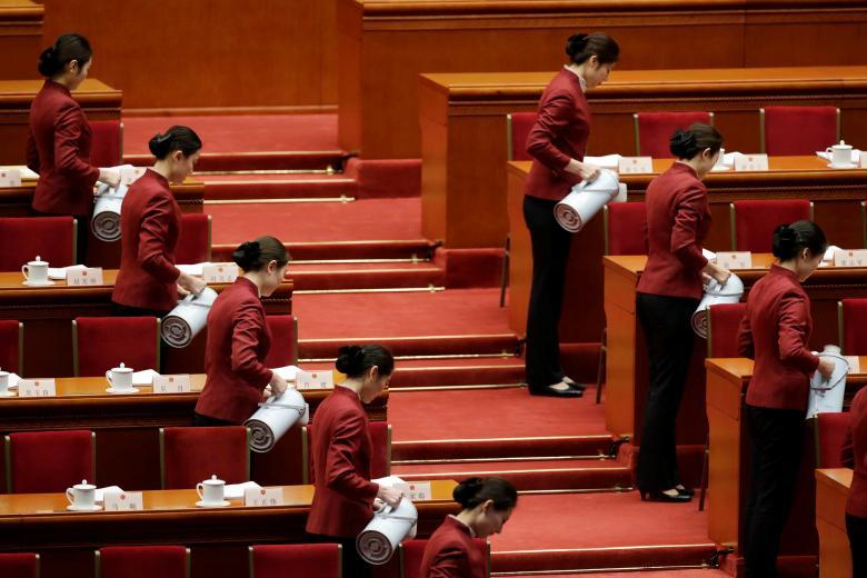 Attendants serve tea before the opening session of the National People's Congress (NPC) at the Great Hall of the People in Beijing. REUTERS/Jason Lee