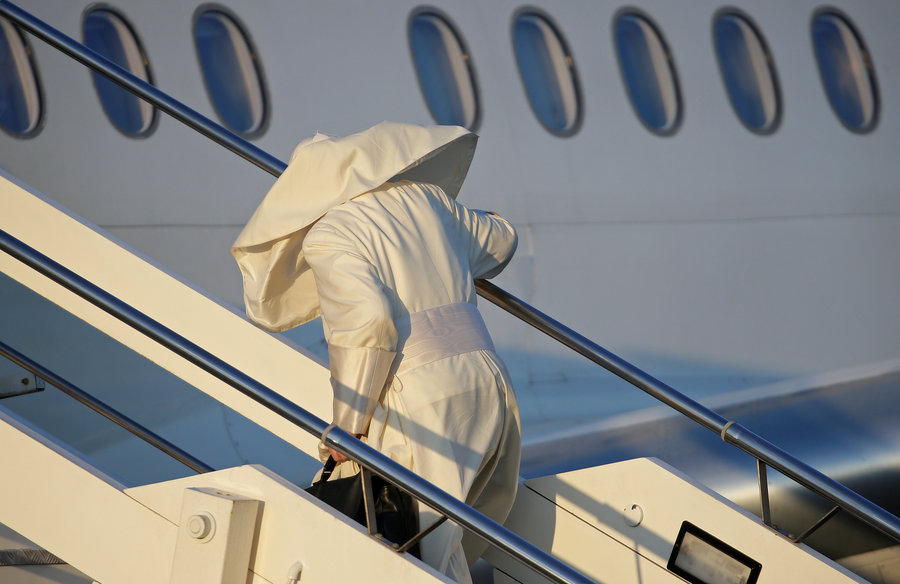 Pope Francis boards for his trip to Chile and Peru at Fiumicino International Airport in Rome, Italy, January 15, 2018. REUTERS/Max Rossi