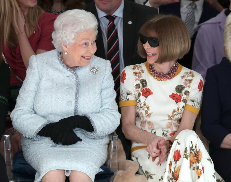 Queen Elizabeth sits next to Vogue Editor-in-Chief Anna Wintour as they view Richard Quinn's runway show during London Fashion Week, February 20. REUTERS/Yui Mok/Pool