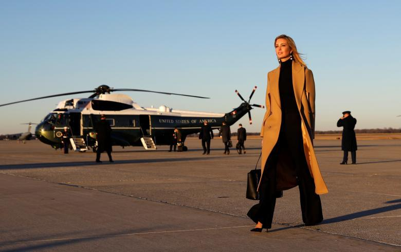 Ivanka Trump walks from Air Force One to a waiting vehicle upon arrival, as President Donald Trump boards Marine One in the background, at Joint Base Andrews in Maryland, January 18, 2018. REUTERS/Kevin Lamarque