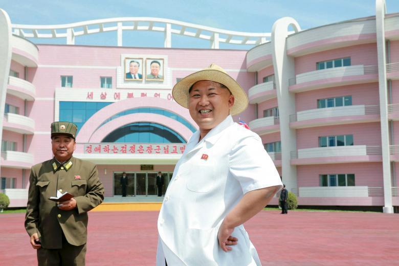 North Korean leader Kim Jong Un outside the Wonsan Baby Home and Orphanage. REUTERS/KCNA