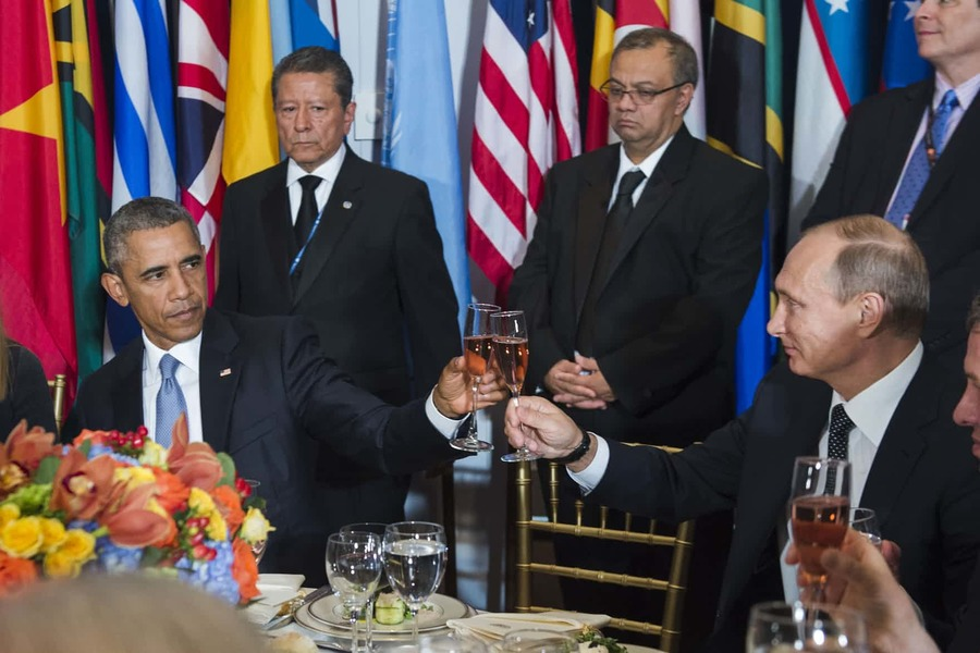 In a photograph provided by the United Nations, US president Barack Obama and Russia's president Vladimir Putin toast each other during a luncheon at the 70th annual United Nations general assembly in New York. Washington accused Moscow of throwing 'gasoline on the fire' of the Syrian civil war, rejecting Russia's claims that its first airstrikes in the war-torn country had targeted Islamic State terrorists Photograph: Amanda Voisard/AP