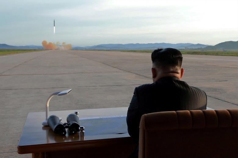 North Korean leader Kim Jong Un watches the launch of a Hwasong-12 missile, September 16. KCNA via REUTERS