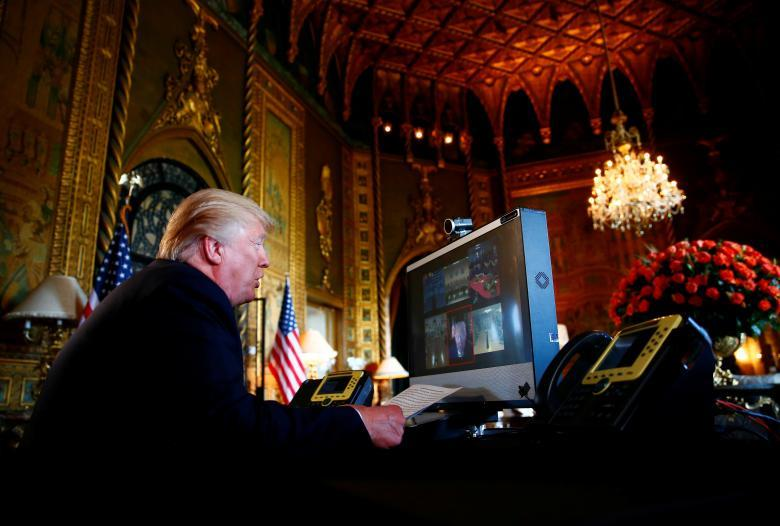 President Donald Trump speaks via video teleconference with troops from Mar-a-Lago estate in Palm Beach, Florida, November 23, 2017. REUTERS/Eric Thayer