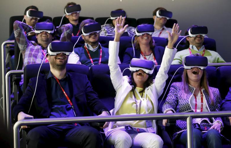 People test Samsung Gear VR glasses at their stand during the Mobile World Congress in Barcelona, Spain, February 23, 2016. REUTERS/Albert Gea