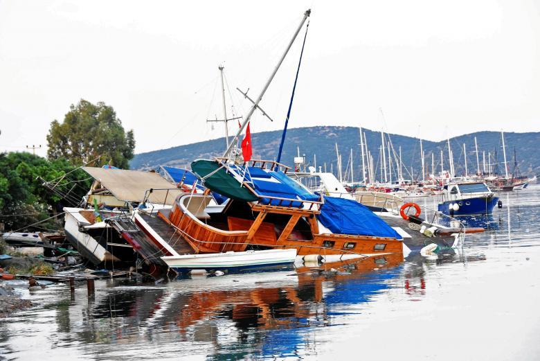Damaged boats are seen after an earthquake and a tsunami in the resort town of Gumbet in Mugla province, Turkey. Yasar Anter/Dogan News Agency via REUTERS