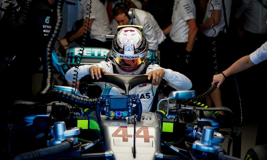 Lewis Hamilton emerges from his Mercedes at the end of the first practice session for the Australian Grand Prix at Melbourne. Photograph: Diego Azubel/EPA