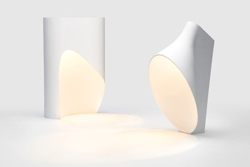 everything-creative: Oculus Project, Prototype 1&2 lamp by RKDS design studio Ryu Kozeki, the founder of RKDS created this two desk lamps made of non-textured plaster. The Prototype 1 lamp can have three differently shaped holes, creating a perfect circle of light on the table. The Prototype 2 has an ellipse hole for a gradient light reflection.