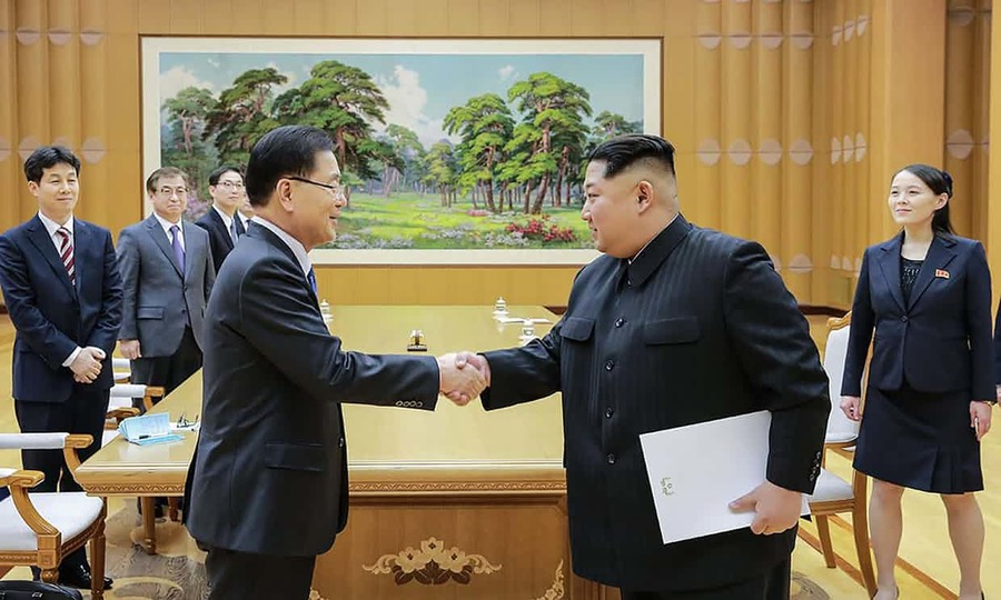 Kim Jong-un, right, with Chung Eui-yong, an envoy of South Korea's president Moon Jae-in. Photograph: HANDOUT/AFP/Getty Images