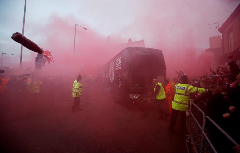 Liverpool fans set off flares and throw missiles at the Manchester City team bus outside the stadium before their match. Action Images via Reuters/Carl Recine