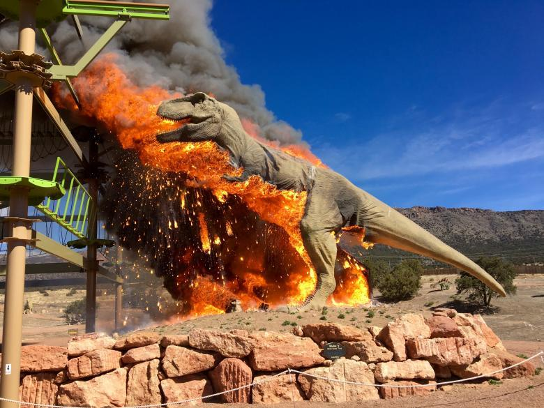 Smoke rises from a replica of a T-Rex after it burst into flames at the Royal Gorge Dinosaur Experience in Canon City, Colorado. Royal Gorge Dinosaur Experience/via REUTERS