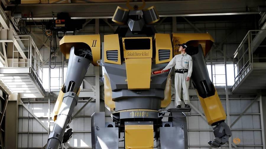 Sakakibara Kikai's engineer Go Sakakibara poses with the bipedal robot Mononofu during its demonstration at its factory in Shinto Village, Gunma Prefecture, Japan, Apr 12, 2018. (Photo: REUTERS/Kim Kyung-Hoon) Read more at https://www.channelnewsasia.com/news/asia/japanese-engineer-builds-giant-robot-to-realise-gundam-dream-10135772
