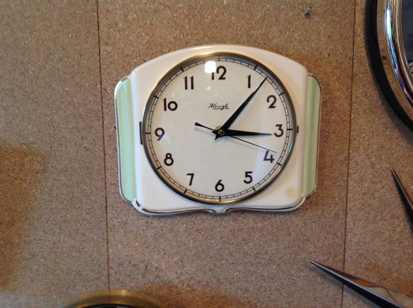 This is a Kienzle kitchen wall clock made from ceramic c1940's/1950's. It has been given a brand new non ticking quiet battery movement.