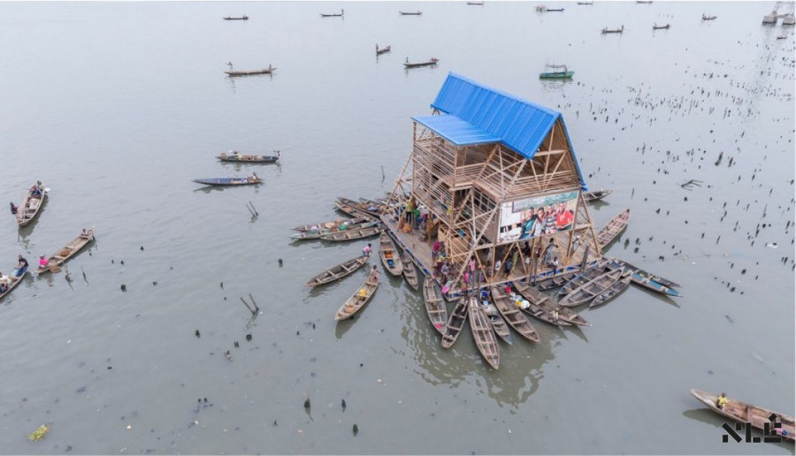 Makoko Floating School by Kunlé Adeyemi is a floating structure, built for the historic water community of Makoko, located on the lagoon heart of Nigeria's largest city, Lagos. Designed to address the community's social and physical needs in view of the impact of climate change and a rapidly urbanizing African context, its main aim is to generate sustainable, ecological, alternative building systems and urban water cultures for the teeming population of Africa's coastal regions.  Designer: [Kunle Adeymi](http://www.nleworks.com/team-member/kunle-adeyemi/) Year: 2012 Location: Lagos, Nigeria Image credit: [Makoko Floating School](http://www.nleworks.com/case/makoko-floating-school/)  Presented by Kunlé Adeyemi at [IdeasCity Arles](http://www.ideas-city.org/arles/public-conference/about-3/)