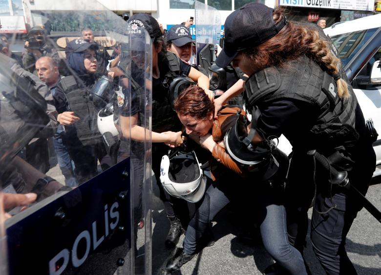 Turkish riot police scuffle with a group of protesters as they attempted to defy a ban and march on Taksim Square to celebrate May Day in Istanbul, Turkey. REUTERS/Murad Sezer