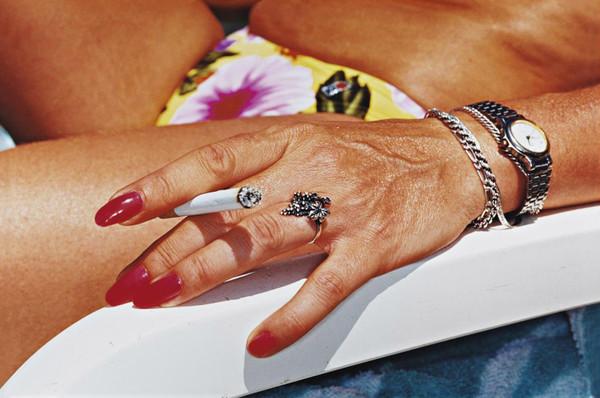martin-parr-common-sense-womans-hand-with-cigarette-benidorm-1997.jpg