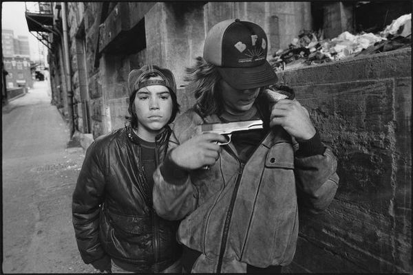 mary-ellen-mark-rat-and-mike-with-a-gun-seattle-washington-1983-via-imgur-com.jpg