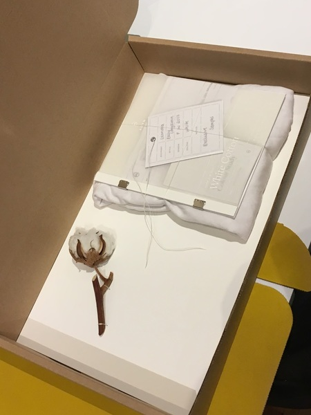 Recycled cardboard boxes cut and assembled by hand. Contains cotton bud, product, waxed bookbinding thread and informational booklet with hangtag. FSC-certified paper and cardstock.