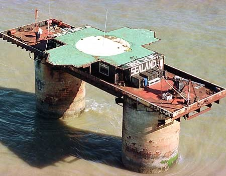 "'The Principality of Sealand is an unrecognized entity, located on HM Fort Roughs, a former World War II Maunsell Sea Fort in the North Sea 10 km (six miles) off the coast of Suffolk, England (51°53'40""N, 1°28'57""E).  Since 1967, the facility has been occupied by the former British Major Paddy Roy Bates; his associates and family claim that it is an independent sovereign state. External commentators generally classify Sealand as a micronation rather than an unrecognized state. While it has been described as the world's smallest nation, Sealand is not currently officially recognised as a sovereign state by any sovereign state. Although Roy Bates claims it is de facto recognised by Germany as they have sent a diplomat to the micronation, and by the United Kingdom after an English court ruled it did not have jurisdiction over Sealand, neither action constitutes de jure recognition as far as the respective countries are concerned.' -from Wikipedia"