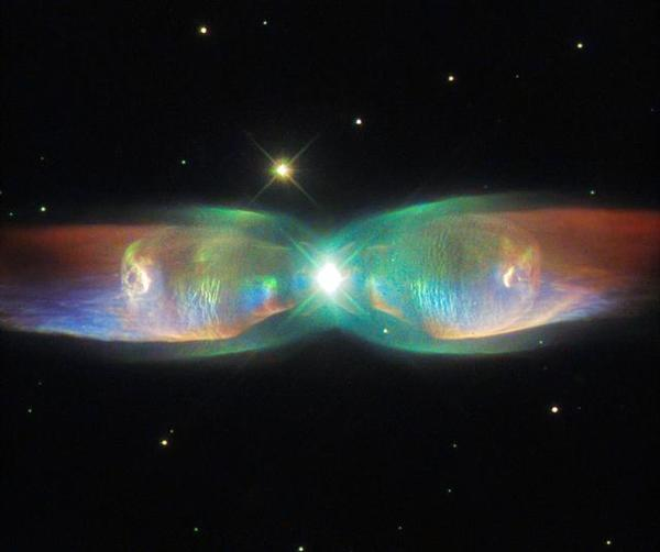 hubble-sees-the-wings-of-a-butterfly-the-twin-jet-nebula_20283986193_o-small.jpg