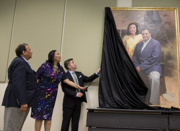 at the moment of the portrait unveiling