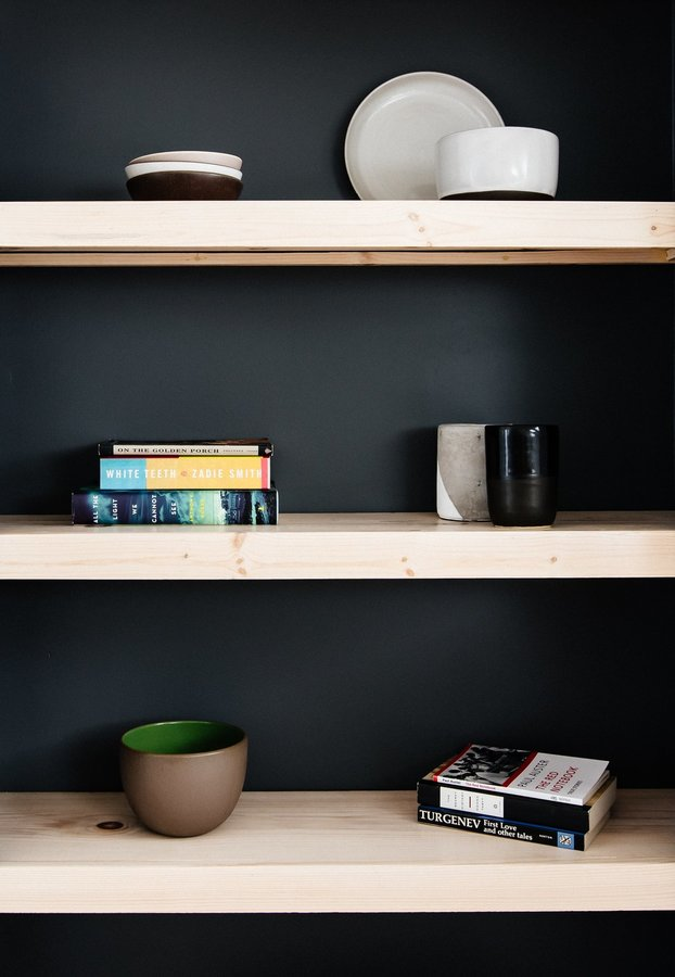 pine-wood-shelves-that-match-the-flooring-with-a-painted-back-wall-add-contrast-to-the-other-end-of-the-bedroom.jpg