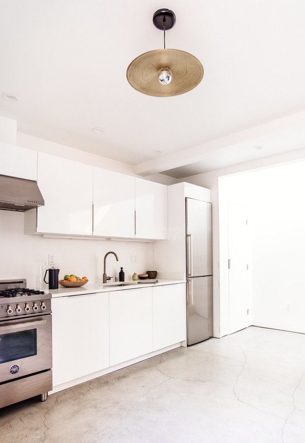 the-functional-one-wall-kitchen-is-open-to-the-first-floor-dining-and-living-area.jpg