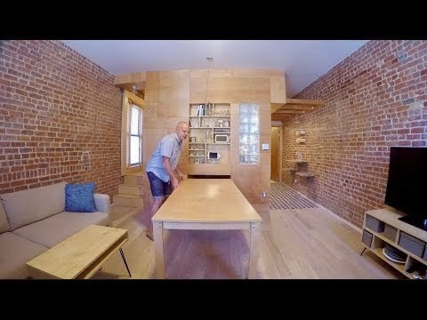 Russian architect Peter Kostelov and his artist wife, Olga Feshina, wanted private rooms to work from home in their aging New York City apartment so they tore down the interior walls and rebuilt the 700-square-foot space with not just a living room, kitchen, bathroom and master bedroom, but two flex spaces which serve for work and guests (via slide-out beds).